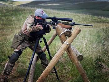 Alex Manita competing in precision rifle competitions.